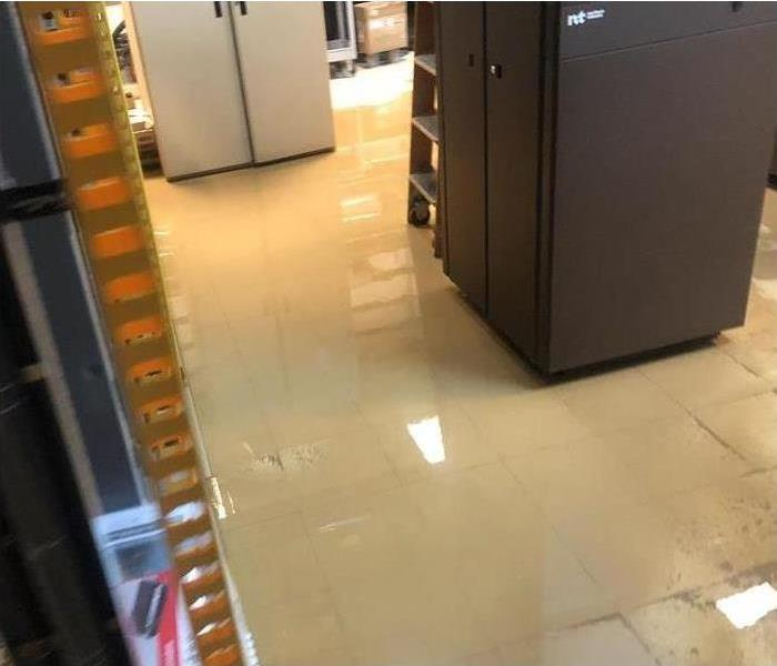 Office floor completely flooded from water damage