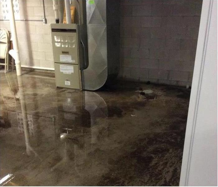 Commercial building concrete floor flooded with water